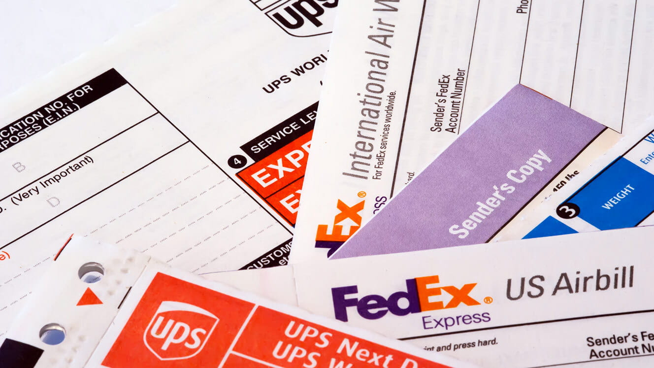 Pile of FedEx and UPS paperwork