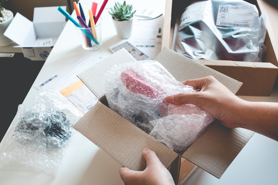 Person prepares package for shipping