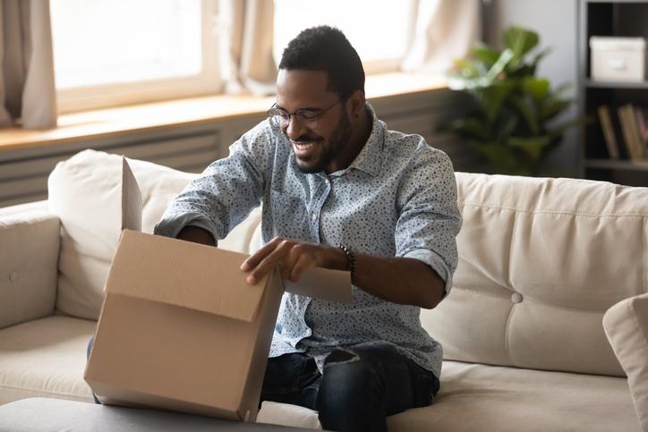 Man opens box