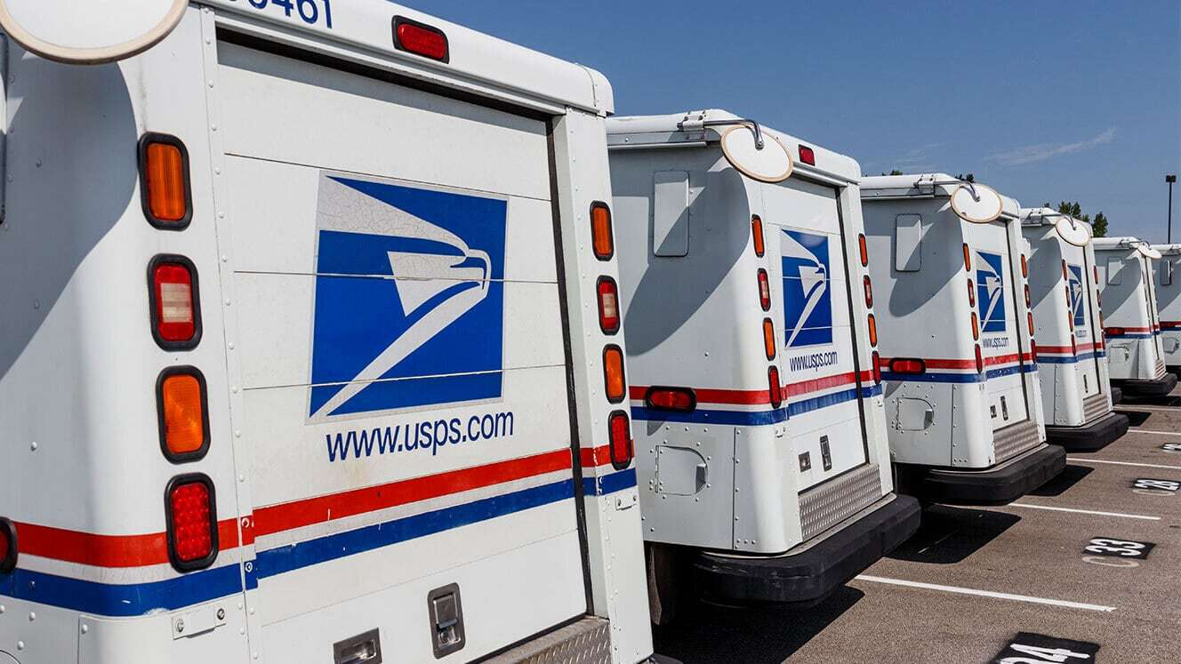 usps trucks parked in a row