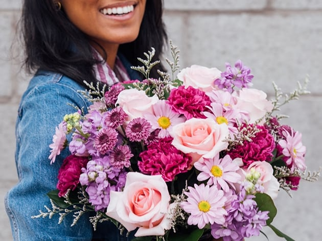 Person smiling with flowers